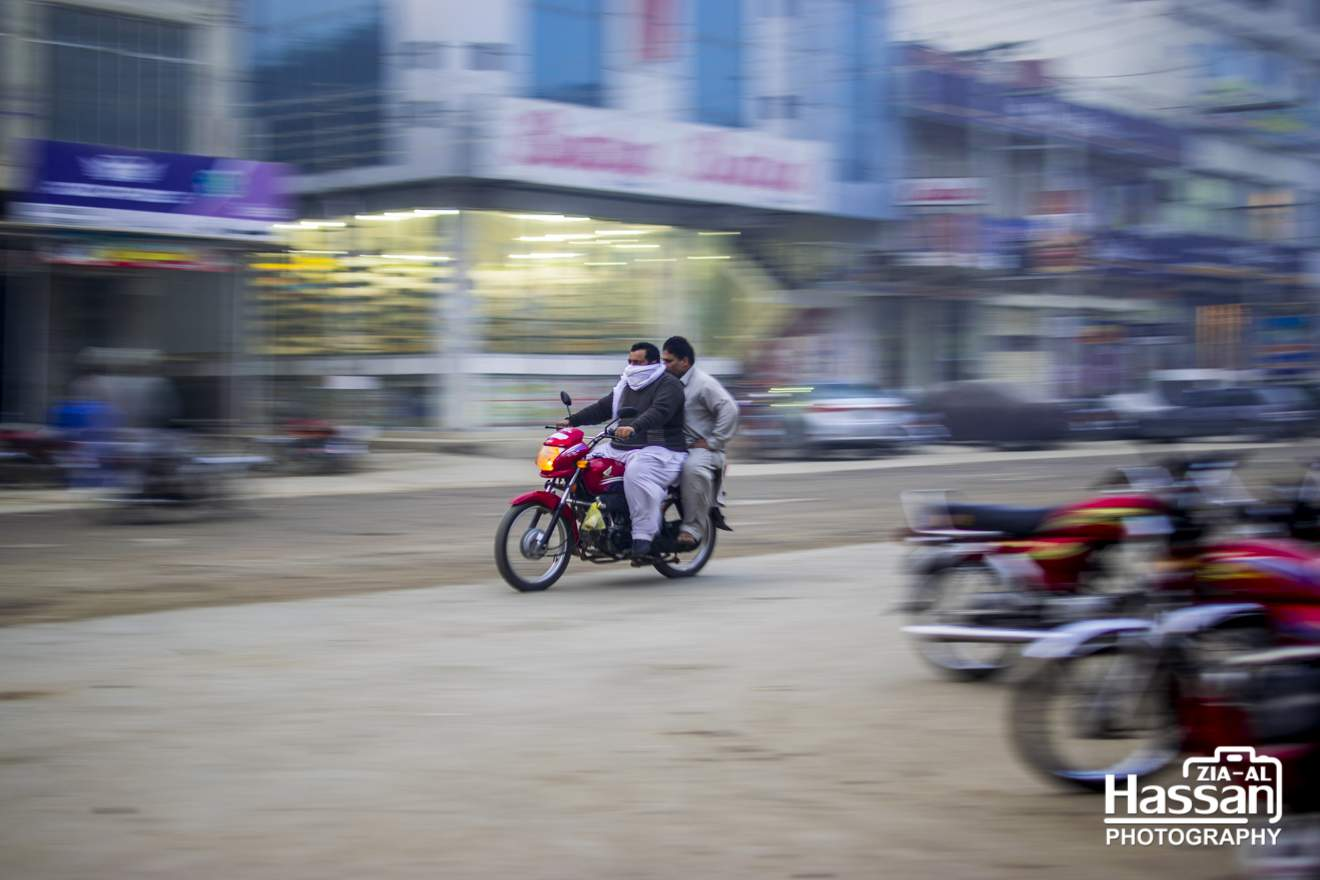 Motion Blur Of A Motorcycle On Road