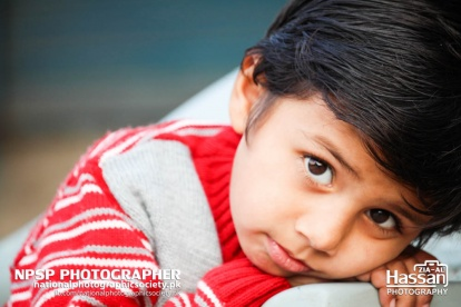 Innocent Child In Red Sweater On Road Side In Pir Mahal